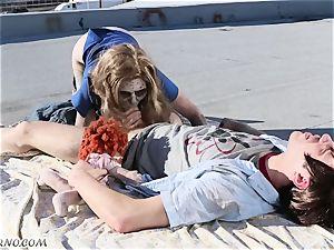 courageous man pokes his zombie-girlfriend
