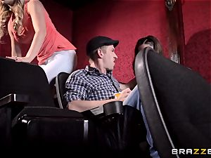 Cherie Deville and Molly Jane pound trouser snake in a porn theatre