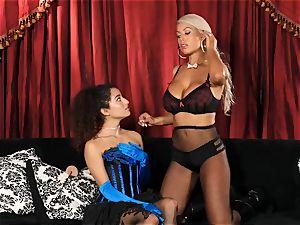 Bridgette B puts warm assistant Lana Lovelace thru her paces