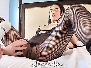 Latina Adrian Hush gets bound onto the couch in nothing but a fishnet