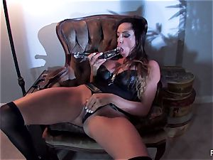 Ariella Ferrera boinks herself with a large glass toy