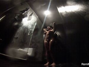 Romi washes off her ideal body in the douche