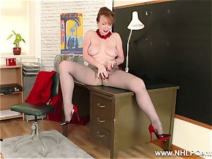 red-haired cougar fingers puss on office desk in tights